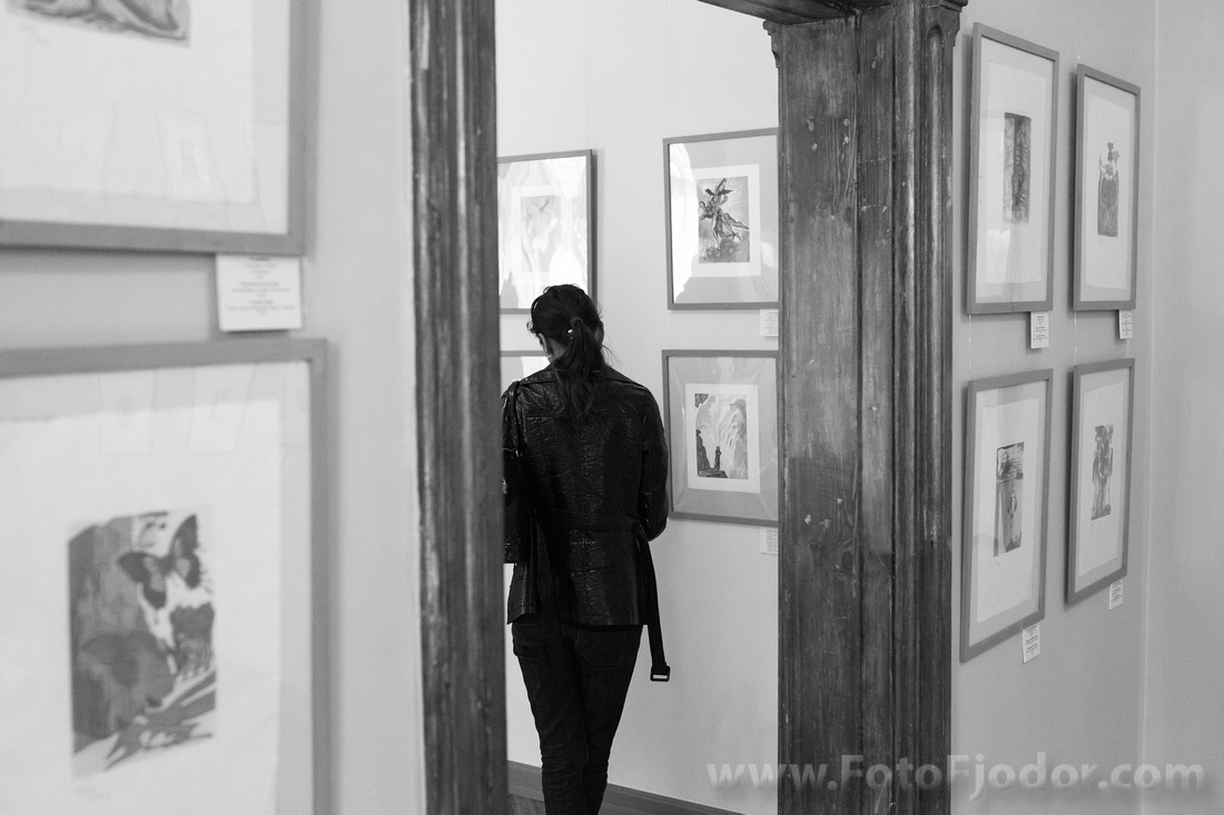 Exhibition visitor looks over the art works of Salvador Dali