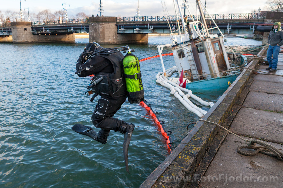 Diver gets into the water in Liepaja Trade channel